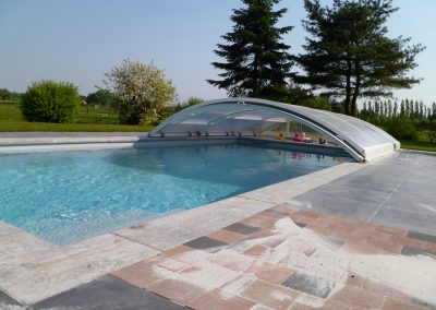 7Zwembad op maat gemaakt voor reeds bestaande overkapping.